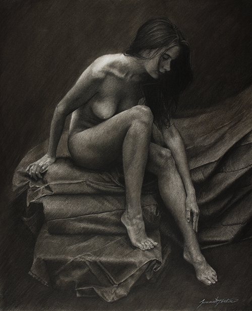 A full nude figurative charcoal drawing of a beautiful young woman sitting on sheets on the edge of a bed or cushions. She is reaching a hand down toward her ankle and looking toward it. She has long hair. The overall drawing is dark in tone.