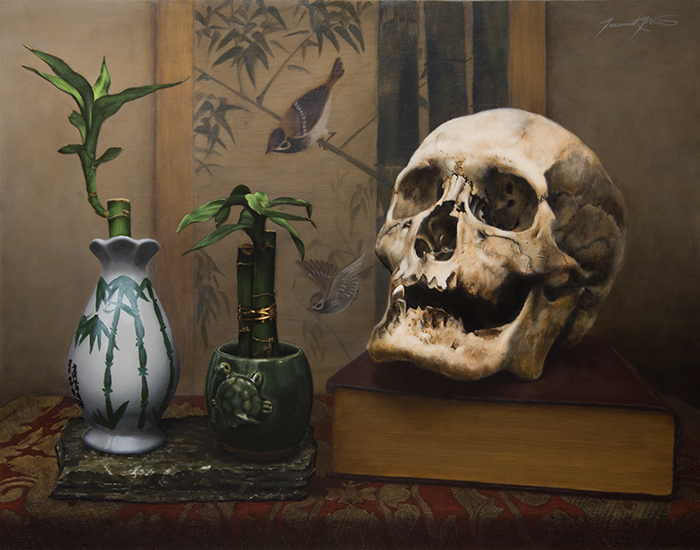 A vanitas or memento mori still life painting with an old skull sitting on top of a large red book with gold pages. To the left of it are two small green bamboo plants in small ceramic vases. One vase is white with an asian style painting of bamboo and chinese letters. The other vase is green and has a small turtle on the side. Both sit on top of a rock which is on top of a red cloth. In the background is a Japanese screen painting of bamboo with birds.